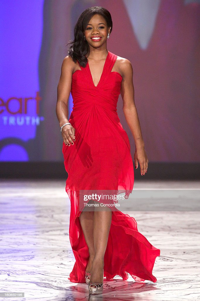 Gabrielle Douglas wearing Pamella Rolland walks the runway at The Heart Truth's Red Dress Collection during Fall 2013 Mercedes-Benz Fashion Week at Hammerstein Ballroom on February 6, 2013 in New York City.