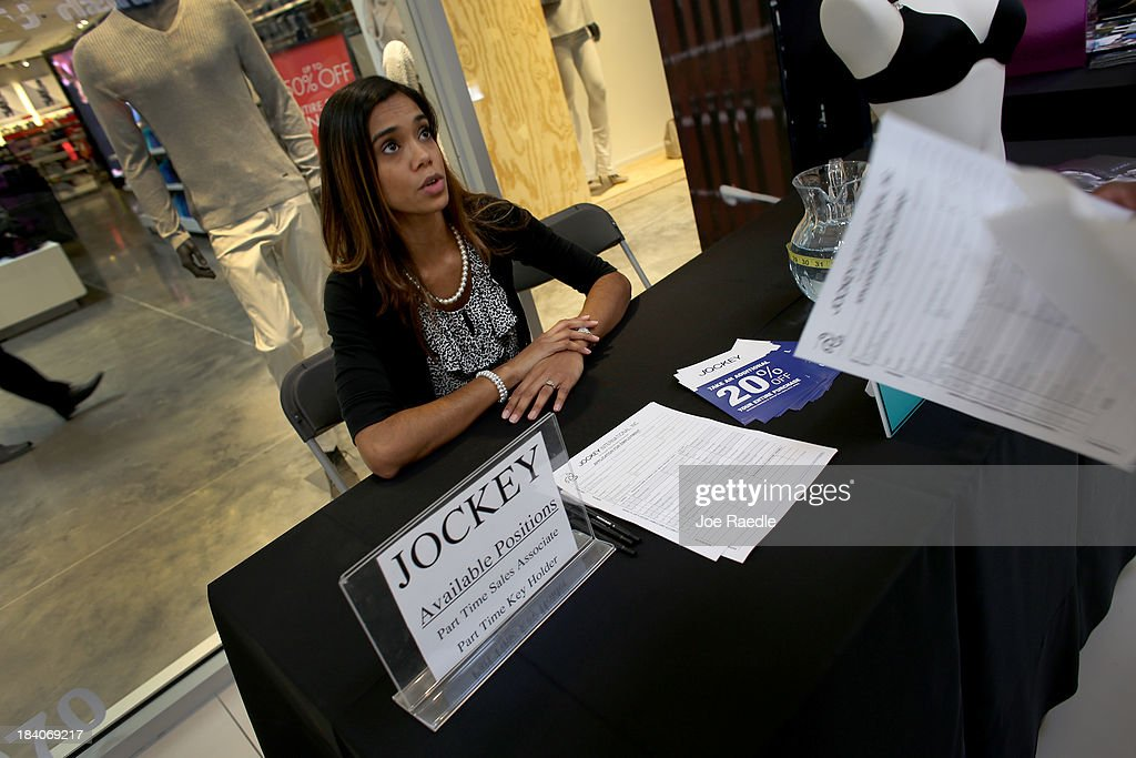 Gabrielle France recruits people for work at Jockey during a job fair at Sawgrass Mills on October 11, 2013 in Sunrise, Florida. As the holiday season approaches many of the roughly 50 retailers at the job fair including Banana Republic, J.Crew Factory, Victoria's Secret and Calvin Klein are starting to hire people for seasonal work as well as continuing to look for qualified full time employees.
