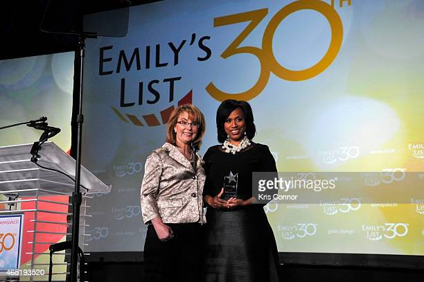 Gabrielle Giffords and Ayanna Pressley appear onstage at EMILY's List 30th Anniversary Gala at Washington Hilton on March 3 2015 in Washington DC