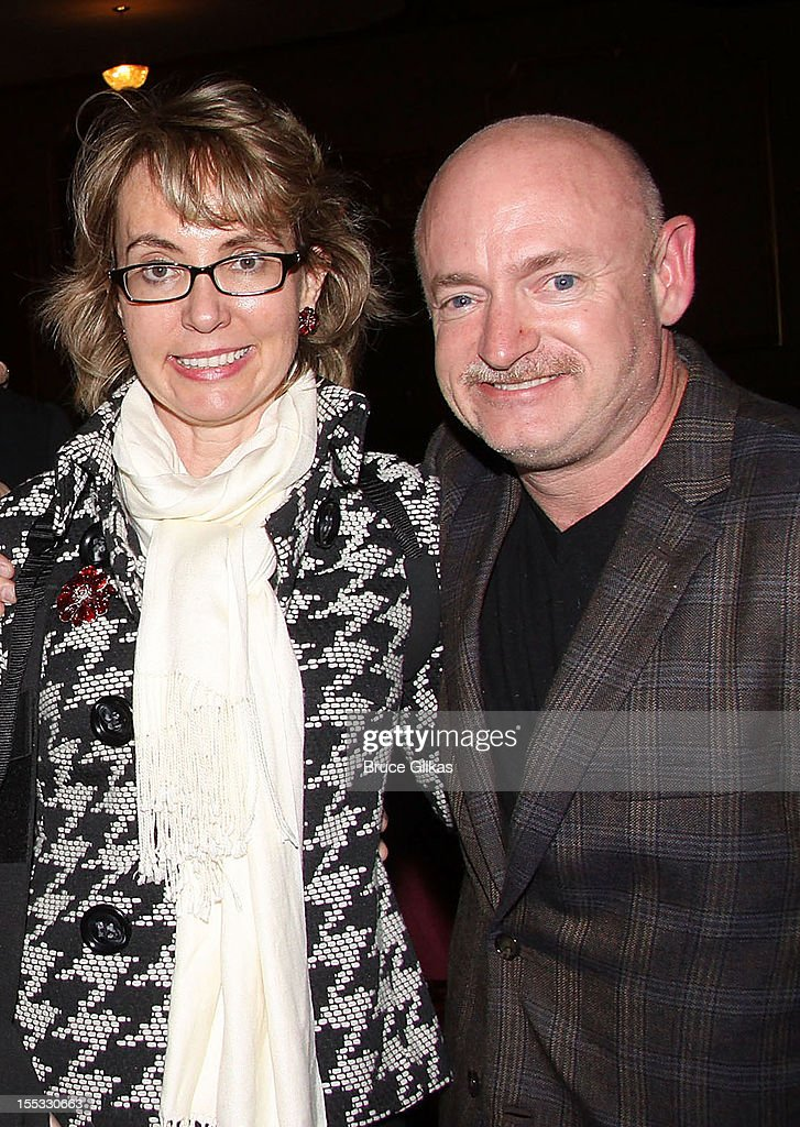 Gabrielle Giffords and husband Mark E. Kelly pose backstage at the hit revival of 'Annie' on Broadway at The Palace Theater on November 2, 2012 in New York City.