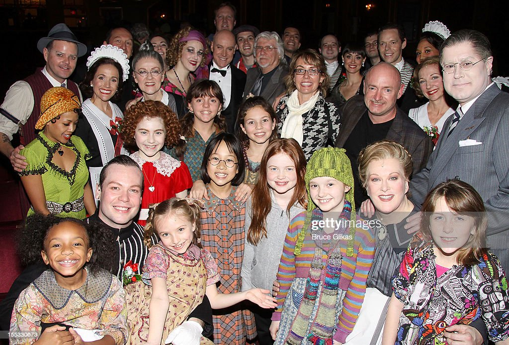 <a gi-track='captionPersonalityLinkClicked' href=/galleries/search?phrase=Gabrielle+Giffords&family=editorial&specificpeople=6961081 ng-click='$event.stopPropagation()'>Gabrielle Giffords</a> and husband Mark E. Kelly pose with the cast backstage at the hit revival of 'Annie' on Broadway at The Palace Theater on November 2, 2012 in New York City.