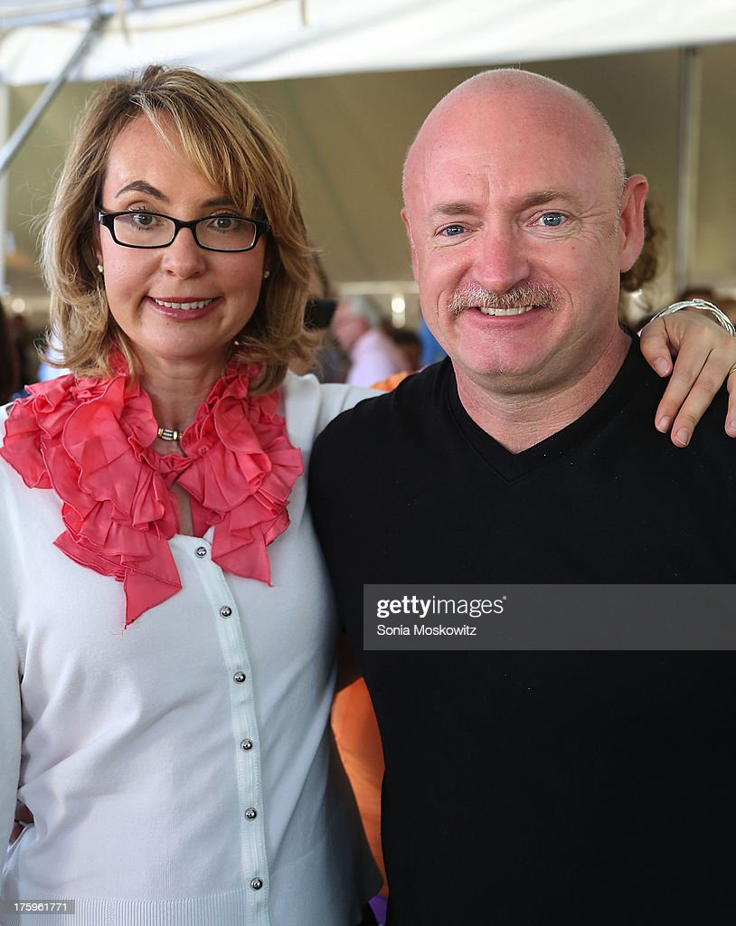 Gabrielle Giffords and Mark Kelly attend East Hampton Library's Authors Night 2013 at Gardiner's Farm on August 10, 2013 in East Hampton, New York.