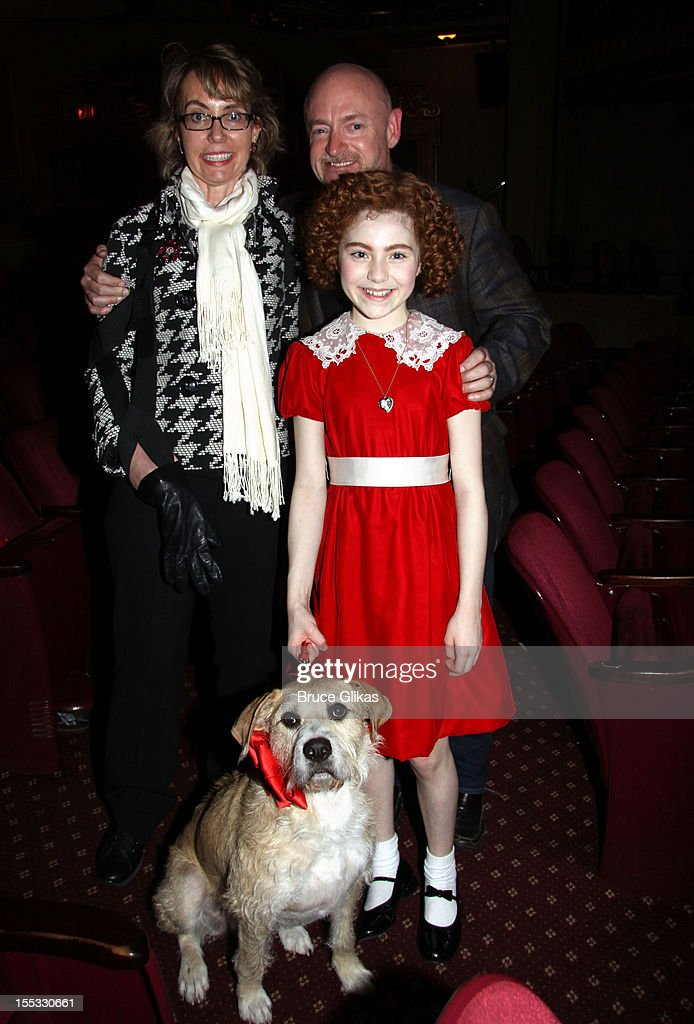 Gabrielle Giffords, husband Mark E. Kelly, Sandy the dog and Lilla Crawford as 'Annie' pose backstage at the hit revival of 'Annie' on Broadway at The Palace Theater on November 2, 2012 in New York City.