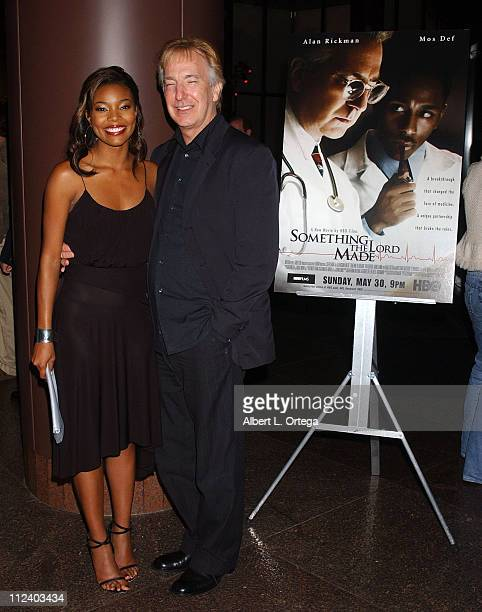 Gabrielle Union and Alan Rickman during 'Something the Lord Made' Los Angeles Premiere Arrivals at The Director's Guild Of America Theater in West...