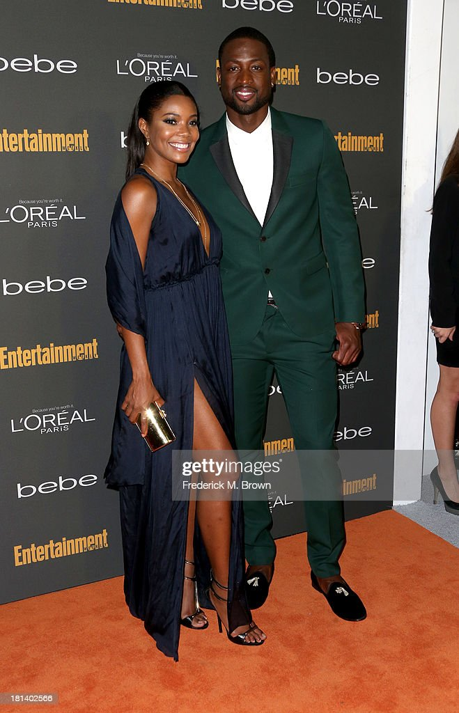 Gabrielle Union and Dwyane Wade arrive at Entertainment Weekly's Pre-Emmy Party at Fig & Olive Melrose Place on September 20, 2013 in West Hollywood, California.