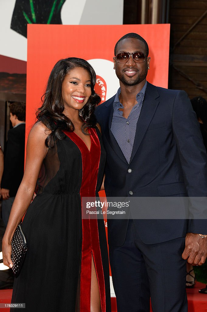 <a gi-track='captionPersonalityLinkClicked' href=/galleries/search?phrase=Gabrielle+Union&family=editorial&specificpeople=202066 ng-click='$event.stopPropagation()'>Gabrielle Union</a> and <a gi-track='captionPersonalityLinkClicked' href=/galleries/search?phrase=Dwyane+Wade&family=editorial&specificpeople=201481 ng-click='$event.stopPropagation()'>Dwyane Wade</a> attend Miu Miu Women's Tales during the 70th Venice International Film Festival on August 29, 2013 in Venice, Italy.