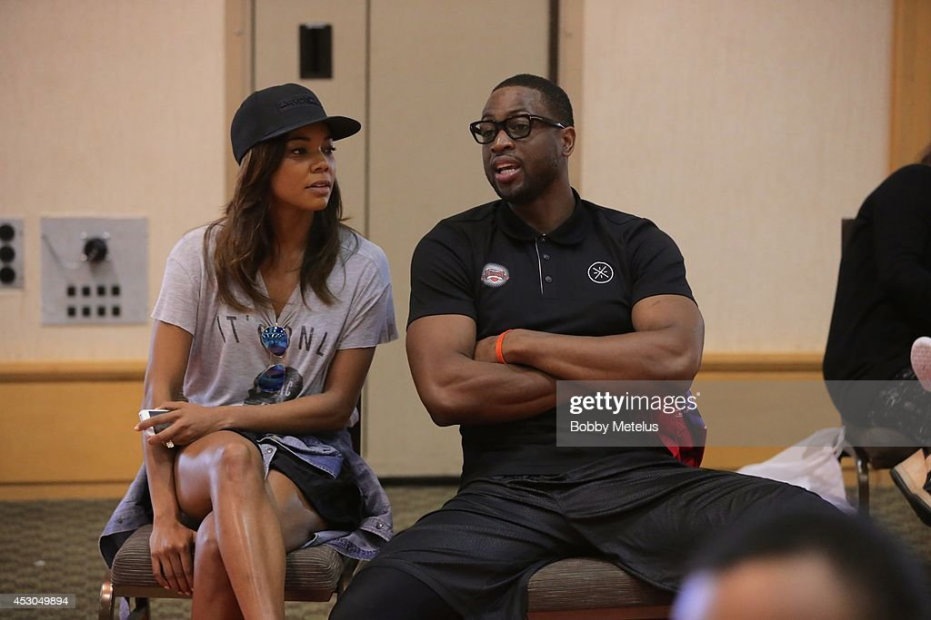 Gabrielle Union and Dwyane Wade enjoy the games at Dwyane Wade Fourth Annual Fantasy Basketball Camp at Westin Diplomat on August 1, 2014 in Hollywood, Florida.