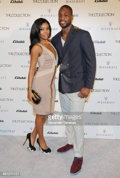 Gabrielle Union and Dwyane Wade make an appearance at the unveiling of the new Maserati Ghibli at The Collection on November 21 2013 in Miami Florida