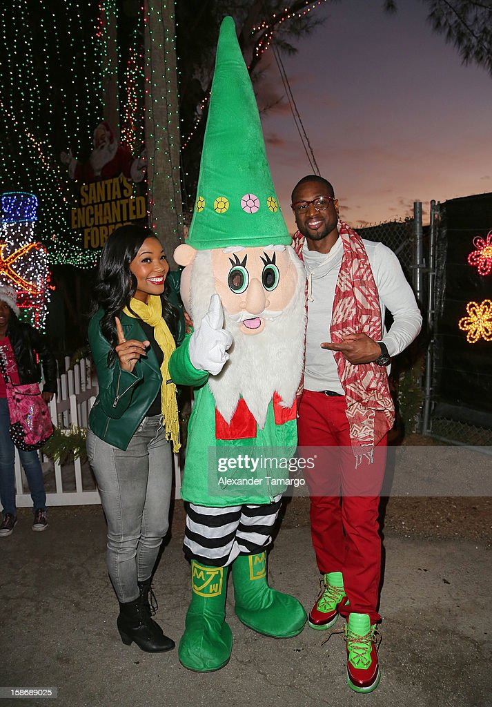 Gabrielle Union and Dwyane Wade make an appearance on behalf of Wade's World Foundation at Santa's Enchanted Forest on December 23, 2012 in Miami, Florida.