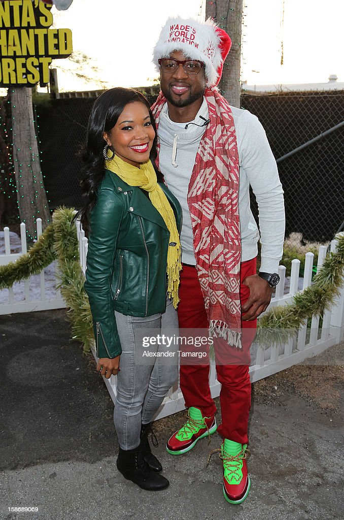 <a gi-track='captionPersonalityLinkClicked' href=/galleries/search?phrase=Gabrielle+Union&family=editorial&specificpeople=202066 ng-click='$event.stopPropagation()'>Gabrielle Union</a> and <a gi-track='captionPersonalityLinkClicked' href=/galleries/search?phrase=Dwyane+Wade&family=editorial&specificpeople=201481 ng-click='$event.stopPropagation()'>Dwyane Wade</a> make an appearance on behalf of Wade's World Foundation at Santa's Enchanted Forest on December 23, 2012 in Miami, Florida.