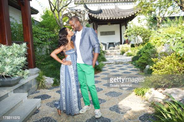 Gabrielle Union and Dwyane Wade take some photos and share a kiss on at Green City Villa on July 11 2013 in Hangzhou China