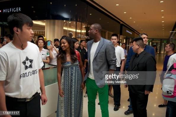Gabrielle Union and Dwyane Wade visit Time Mall for Wade's 3D Headphones Launch Event on July 11 2013 in Hangzhou China