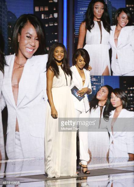 Gabrielle Union and Regina Hall speak onstage during the 'BET AWARDS' 14 held at Nokia Theater LA LIVE on June 29 2014 in Los Angeles California