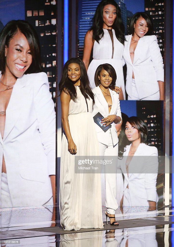 Gabrielle Union (L) and Regina Hall speak onstage during the 'BET AWARDS' 14 held at Nokia Theater L.A. LIVE on June 29, 2014 in Los Angeles, California.