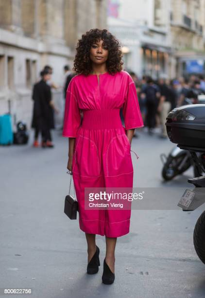 Gabrielle Union wearing a pink dress outside Hermes during Paris Fashion Week Menswear Spring/Summer 2018 Day Four on June 24 2017 in Paris France