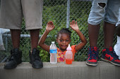 Gabrielle Walker protests the killing of teenager Michael Brown on August 17 2014 in Ferguson Missouri Despite the Brown family's continued call for...