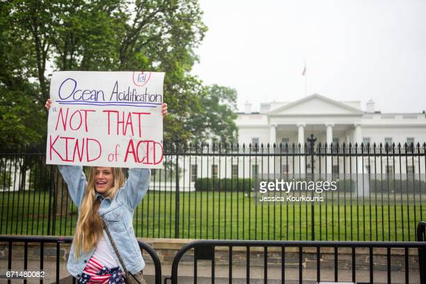 Gabrielle Walters poses for photographs in front of The White House before heading to the National Mall for the March for Science on April 22 2017 in...
