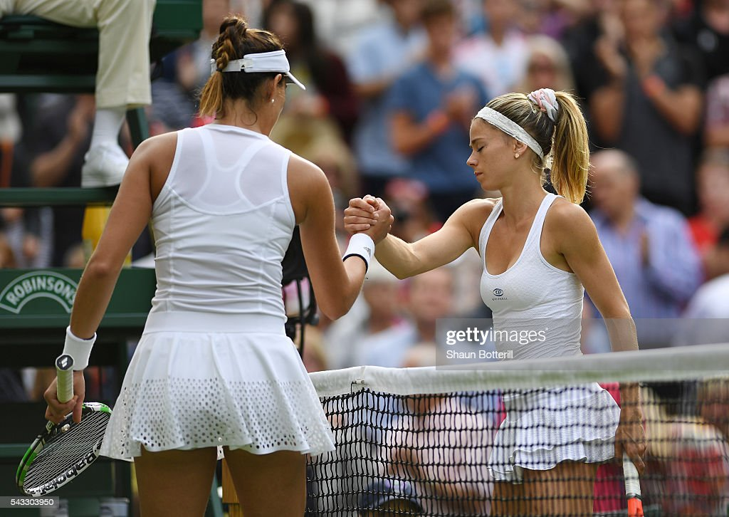 Gabrine Muguruza of Spain and <a gi-track='captionPersonalityLinkClicked' href=/galleries/search?phrase=Camila+Giorgi&family=editorial&specificpeople=7865503 ng-click='$event.stopPropagation()'>Camila Giorgi</a> of Italy shake hands following victory for Gabrine Muguruza during the Ladies Singles first round match against <a gi-track='captionPersonalityLinkClicked' href=/galleries/search?phrase=Camila+Giorgi&family=editorial&specificpeople=7865503 ng-click='$event.stopPropagation()'>Camila Giorgi</a> of Italy on day one of the Wimbledon Lawn Tennis Championships at the All England Lawn Tennis and Croquet Club on June 27th, 2016 in London, England.