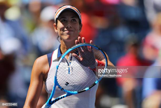 Gabrine Muguruza of Spain celebrates after defeating Varvara Lepchenko of the United States in her first round Women's Singles match on Day One of...