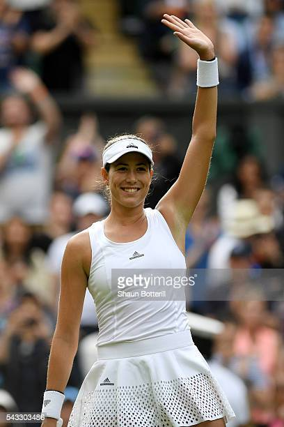 Gabrine Muguruza of Spain celebrates victory following the Ladies Singles first round match against Camila Giorgi of Italy on day one of the...