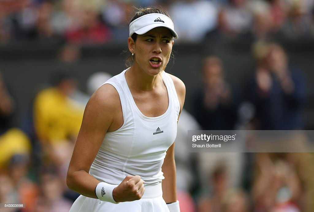 Gabrine Muguruza of Spain celebrates victory following the Ladies Singles first round match against Camila Giorgi of Italy on day one of the Wimbledon Lawn Tennis Championships at the All England Lawn Tennis and Croquet Club on June 27th, 2016 in London, England.