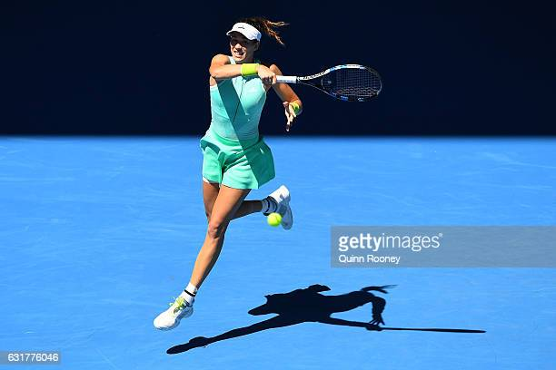 Gabrine Muguruza of Spain plays a forehand in her first round match against Marina Erakovic of New Zealand on day one of the 2017 Australian Open at...