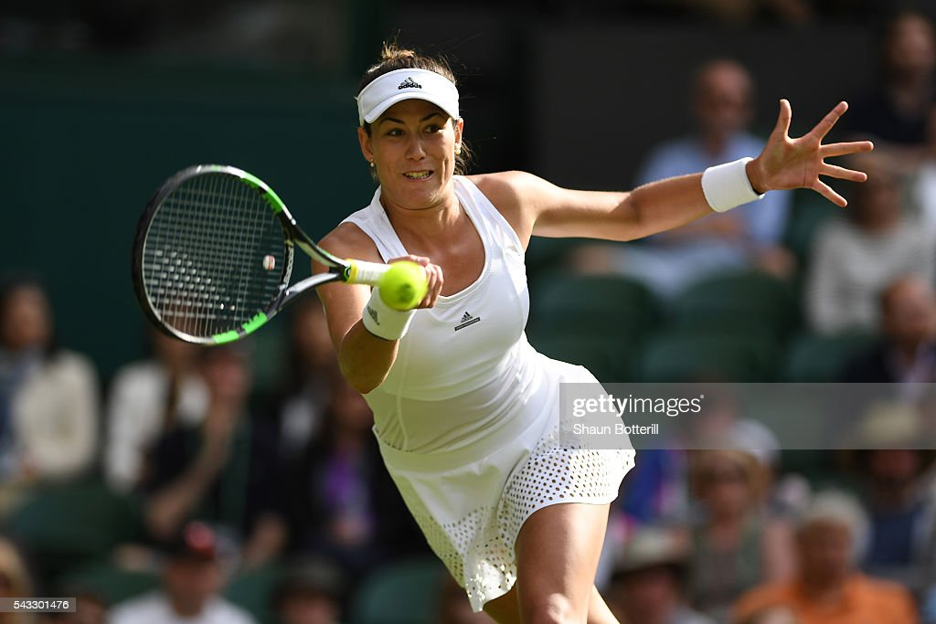 Gabrine Muguruza of Spain plays a forehand shot during the Ladies Singles first round match against Camila Giorgi of Italy on day one of the Wimbledon Lawn Tennis Championships at the All England Lawn Tennis and Croquet Club on June 27th, 2016 in London, England.