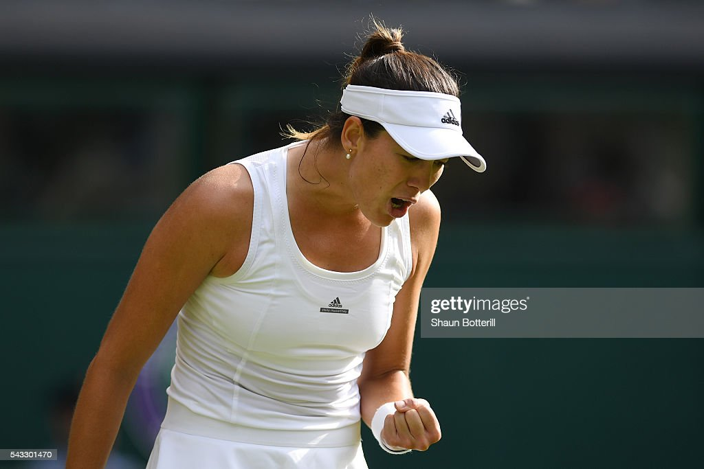 Gabrine Muguruza of Spain reacts during the Ladies Singles first round match against Camila Giorgi of Italy on day one of the Wimbledon Lawn Tennis Championships at the All England Lawn Tennis and Croquet Club on June 27th, 2016 in London, England.