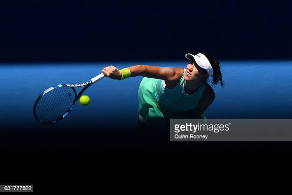 Gabrine Muguruza of Spain serves in her first round match against Marina Erakovic of New Zealand on day one of the 2017 Australian Open at Melbourne...