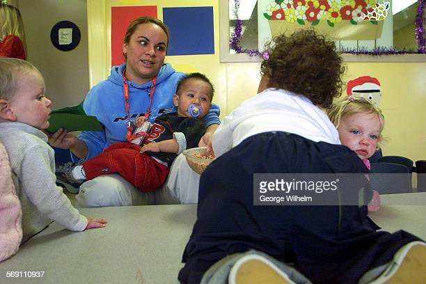 – Gaby Alarcon who works at La Petite Academy a day care facility in Santa Clarita is surrounded by a group of toddlers who produce quite a few dirty...