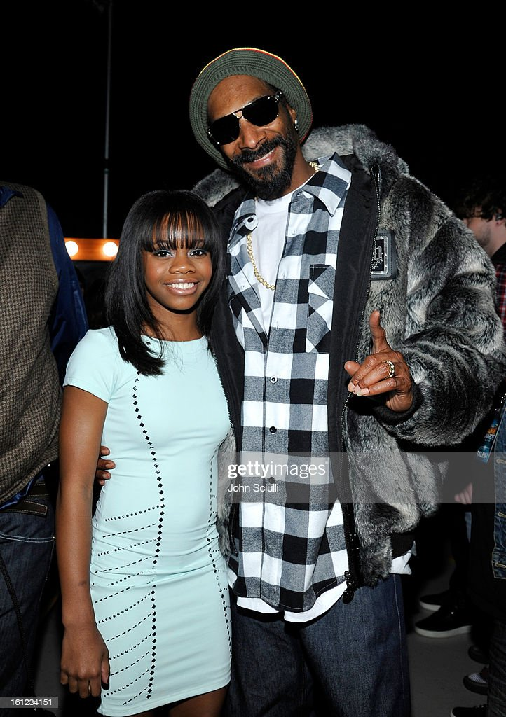 Gaby Douglas and Snoop Lion attends the Third Annual Hall of Game Awards hosted by Cartoon Network at Barker Hangar on February 9, 2013 in Santa Monica, California. 23270_004_JS_0245.JPG