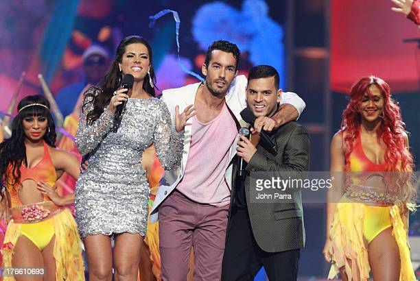 Gaby Espino Aaron Diaz and Tito El Bambino on stage during Telemundo's Premios Tu Mundo Awards at American Airlines Arena on August 15 2013 in Miami...