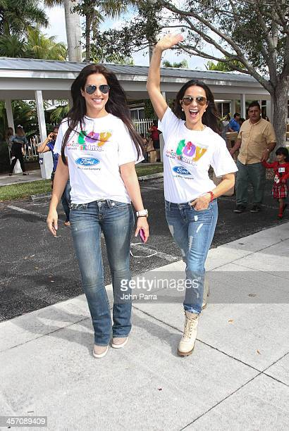 Gaby Espino and Catherine Siachoque arrive at Amigos For Kids 21st Annual Holiday Toy Drive on December 15 2013 in Miami Florida