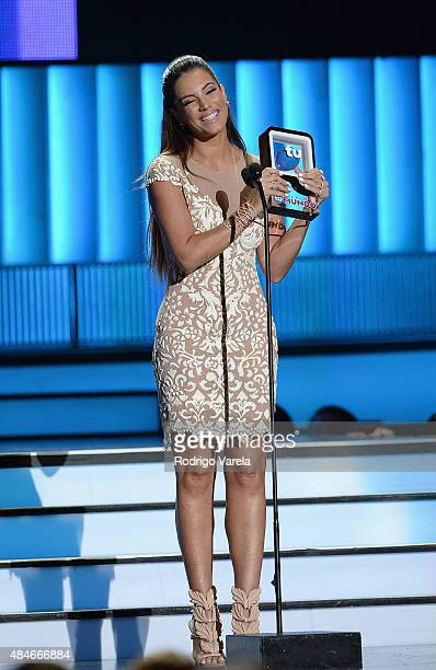 Gaby Espino receives an award onstage at Telemundo's 'Premios Tu Mundo' Awards 2015 at American Airlines Arena on August 20 2015 in Miami Florida