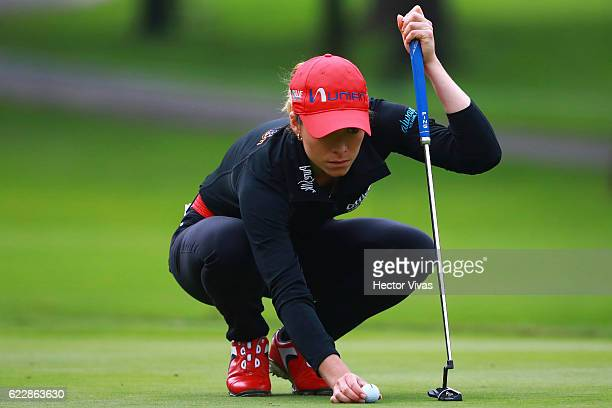 Gaby Lopez of Mexico eyes up a putt during the Lorena Ochoa Invitational 2016 at Club de Golf on November 12 2016 in Mexico City Mexico