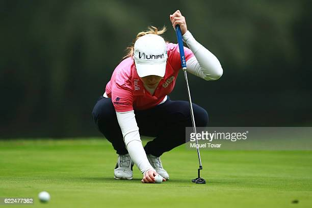 Gaby Lopez of Mexico lines up her ball during the Lorena Ochoa Invitational 2016 at Club de Golf on November 11 2016 in Mexico City Mexico