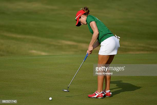 Gaby Lopez of Mexico putts on the seventh green on Day 15 of the Rio 2016 Olympic Games at the Olympic Golf Course on August 20 2016 in Rio de...