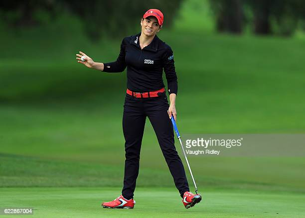 Gaby Lopez of Mexico reacts after sinking a long putt on the 18th green during the third round of the Citibanamex Lorena Ochoa Invitational Presented...