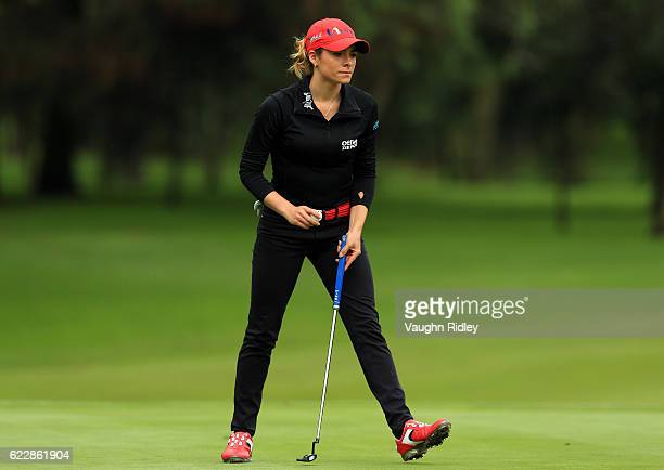 Gaby Lopez of Mexico retrieves her ball after sinking her putt on the 4th hole during the third round of the Citibanamex Lorena Ochoa Invitational...