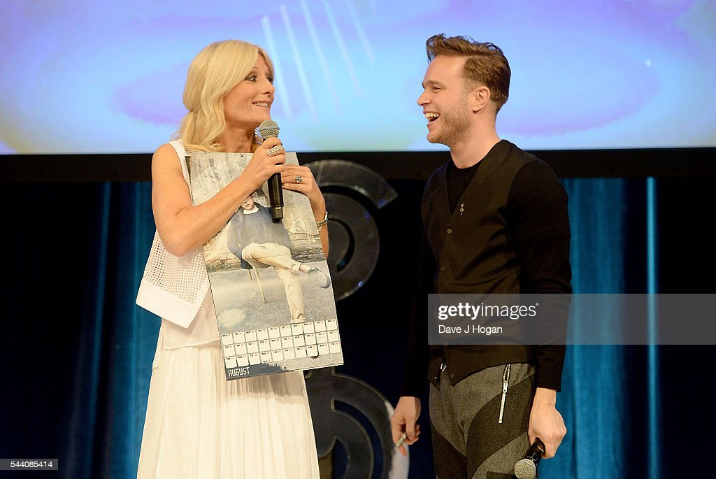 Gaby Roslin and Olly Murs on stage during the Nordoff Robbins O2 Silver Clef Awards on July 1, 2016 in London, United Kingdom.