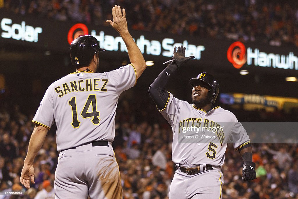 <a gi-track='captionPersonalityLinkClicked' href=/galleries/search?phrase=Gaby+Sanchez&family=editorial&specificpeople=4945789 ng-click='$event.stopPropagation()'>Gaby Sanchez</a> #14 of the Pittsburgh Pirates and Josh Harrison #5 celebrate after scoring runs on a three run home run hit by Clint Barmes (not pictured) against the San Francisco Giants during the seventh inning at AT&T Park on August 23, 2013 in San Francisco, California.