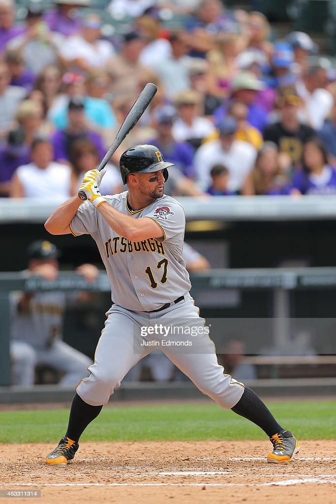 Gaby Sanchez of the Pittsburgh Pirates bats against the Colorado Rockies at Coors Field on July 27 2014 in Denver Colorado The Pirates defeated the...