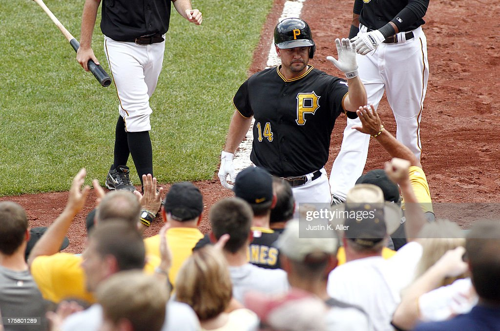 <a gi-track='captionPersonalityLinkClicked' href=/galleries/search?phrase=Gaby+Sanchez&family=editorial&specificpeople=4945789 ng-click='$event.stopPropagation()'>Gaby Sanchez</a> #14 of the Pittsburgh Pirates celebrates after hitting a sacrifice fly in the seventh inning against the Miami Marlins during the game on August 8, 2013 at PNC Park in Pittsburgh, Pennsylvania.