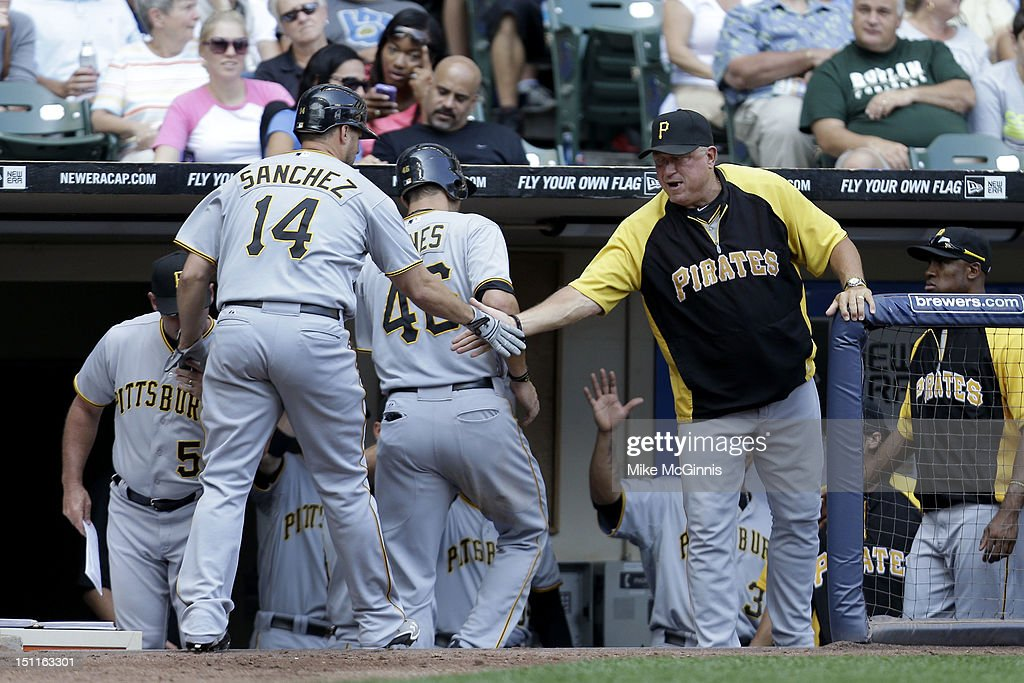 <a gi-track='captionPersonalityLinkClicked' href=/galleries/search?phrase=Gaby+Sanchez&family=editorial&specificpeople=4945789 ng-click='$event.stopPropagation()'>Gaby Sanchez</a> #14 of the Pittsburgh Pirates celebrates outside the Pirates' dugout after hitting a two-run homer scoring Garrett Jones in the top of the 5th inning against the Milwaukee Brewers at Miller Park on September 02, 2012 in Milwaukee, Wisconsin.
