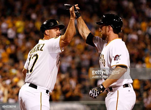 Gaby Sanchez of the Pittsburgh Pirates celebrates with Ike Davis after hitting a three run home run in the eighth inning against the St Louis...