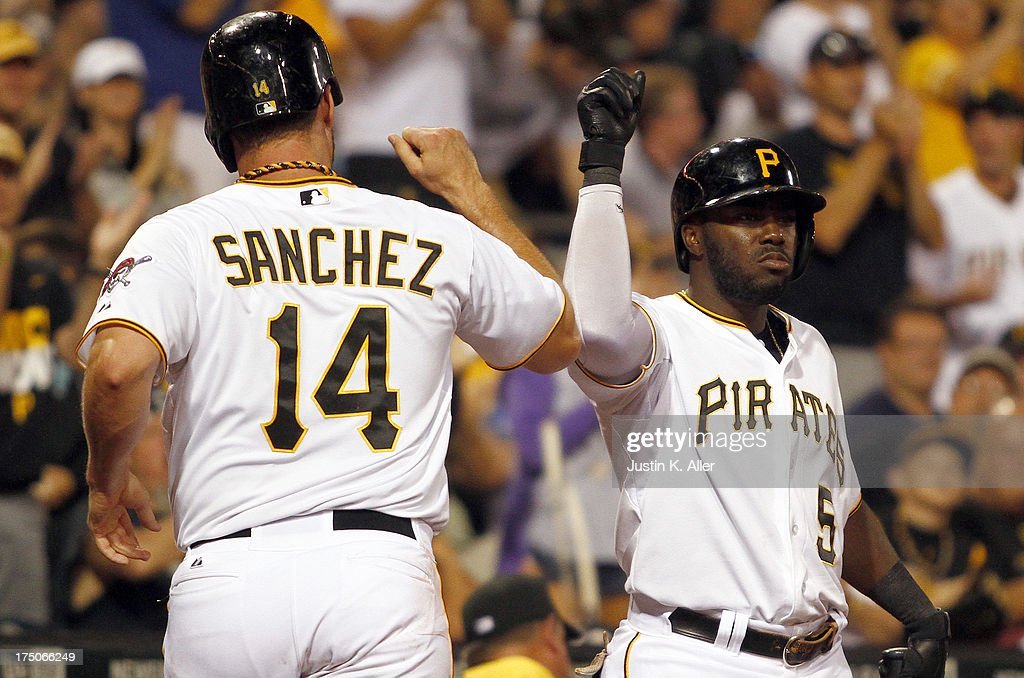 <a gi-track='captionPersonalityLinkClicked' href=/galleries/search?phrase=Gaby+Sanchez&family=editorial&specificpeople=4945789 ng-click='$event.stopPropagation()'>Gaby Sanchez</a> #14 of the Pittsburgh Pirates celebrates with Josh Harrison #5 after scoring on a seventh inning sacrifice fly against the St. Louis Cardinals during game two of a doubleheader on July 30, 2013 at PNC Park in Pittsburgh, Pennsylvania.
