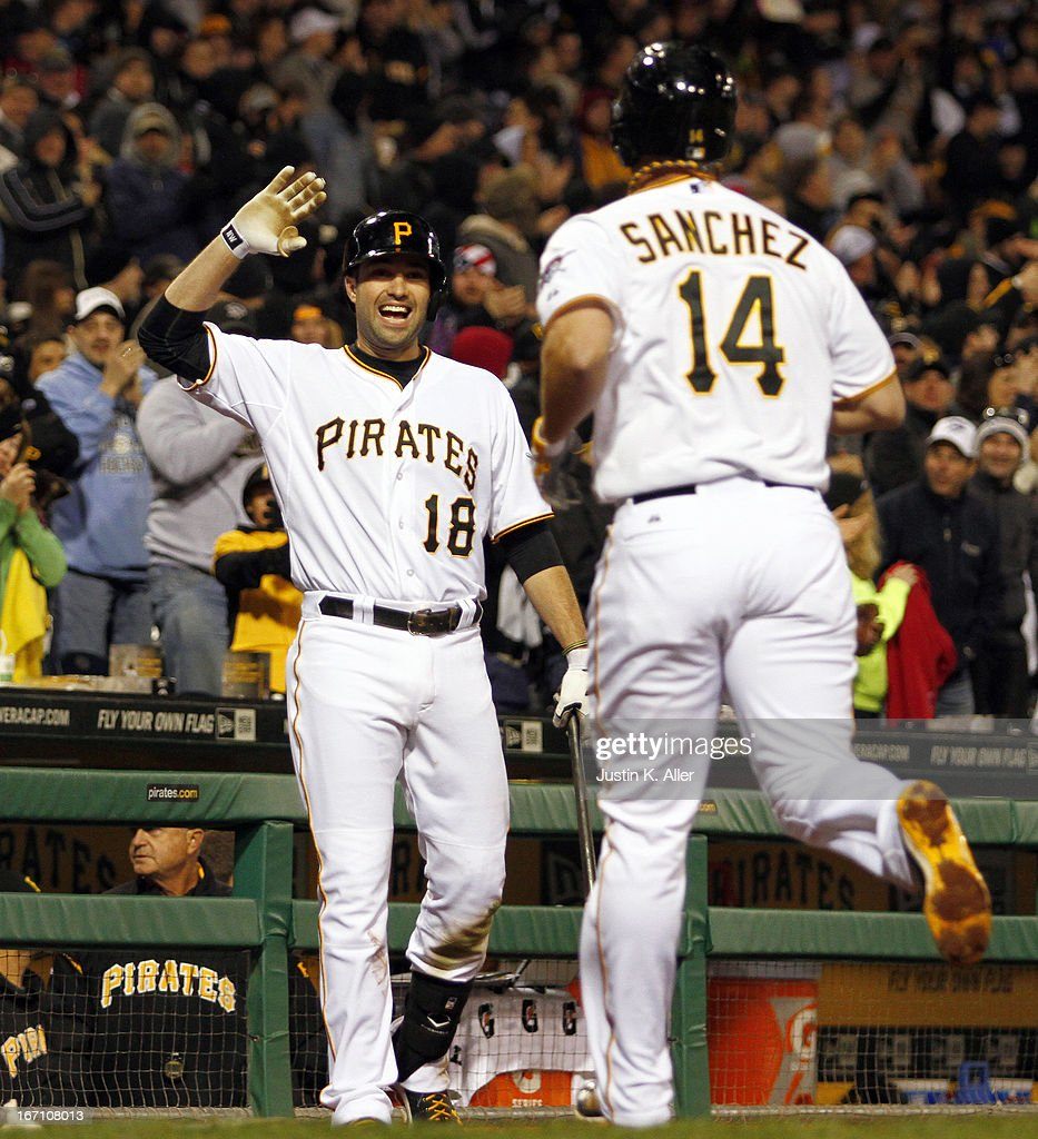 <a gi-track='captionPersonalityLinkClicked' href=/galleries/search?phrase=Gaby+Sanchez&family=editorial&specificpeople=4945789 ng-click='$event.stopPropagation()'>Gaby Sanchez</a> #14 of the Pittsburgh Pirates celebrates with Neil Walker #18 after hitting a two-run home run in the sixth inning against the Atlanta Braves during the game on April 20, 2013 at PNC Park in Pittsburgh, Pennsylvania.