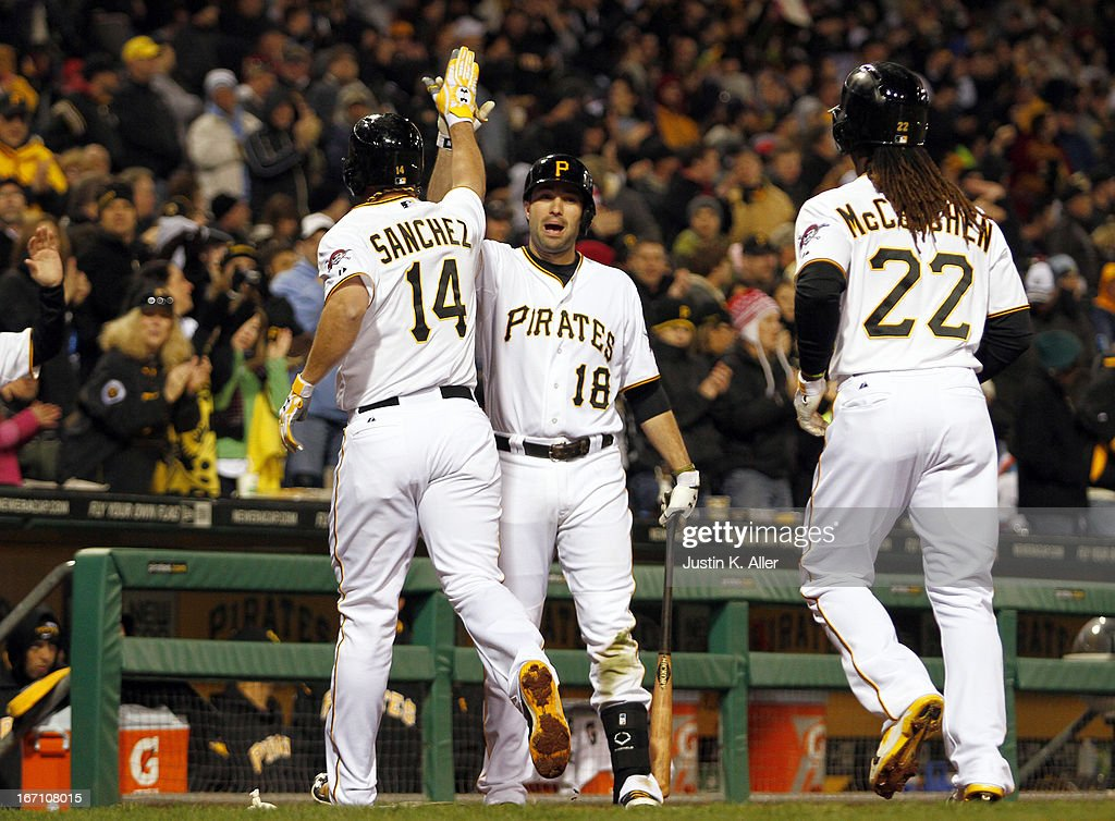Gaby Sanchez #14 of the Pittsburgh Pirates celebrates with Neil Walker #18 after hitting a two-run home run in the sixth inning against the Atlanta Braves during the game on April 20, 2013 at PNC Park in Pittsburgh, Pennsylvania.