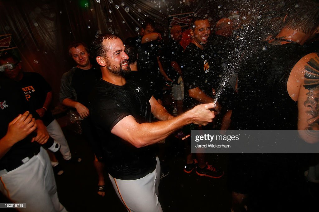 Gaby Sanchez of the Pittsburgh Pirates celebrates with teammates in the clubhouse following their 62 win against the Cincinnati Reds during the...