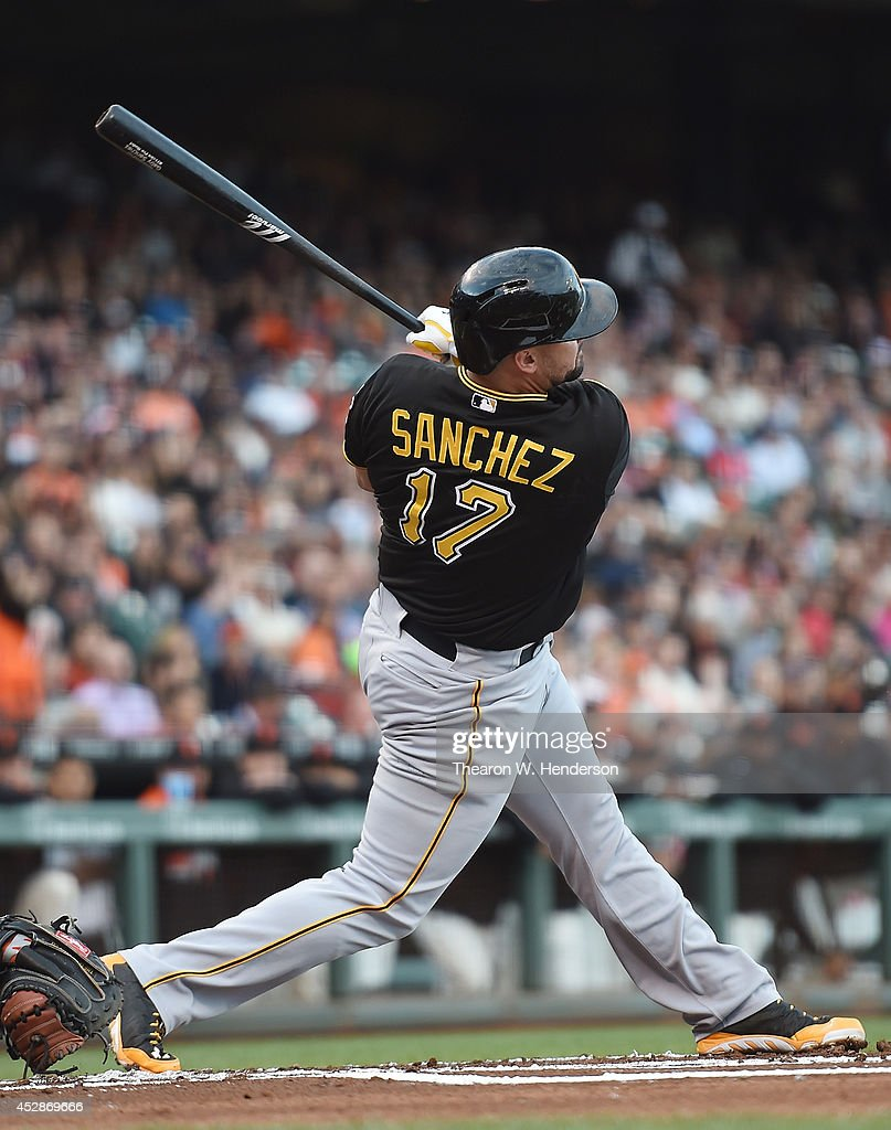 <a gi-track='captionPersonalityLinkClicked' href=/galleries/search?phrase=Gaby+Sanchez&family=editorial&specificpeople=4945789 ng-click='$event.stopPropagation()'>Gaby Sanchez</a> #17 of the Pittsburgh Pirates hits a sacrifice fly scoring Josh Harrison #5 against the San Francisco Giants in the top of the first inning at AT&T Park on July 28, 2014 in San Francisco, California.